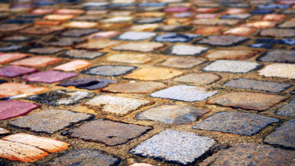 Background of colorful cobblestone pavement close up