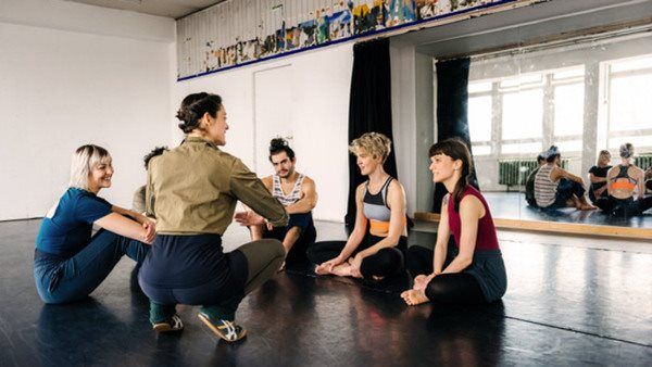 Mature female dancing teacher with her class during a break