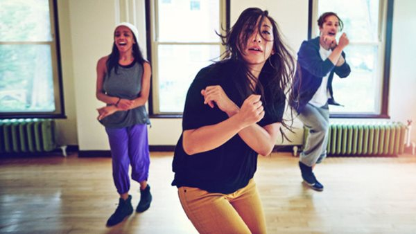 Shot of a group of young people dancing together in a studio